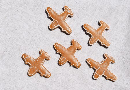 Gingerbreads in a shape of airplane on a light background