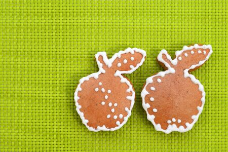 Gingerbread apples on bright green background