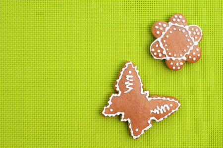 Creative composition with gingerbreads on bright green background