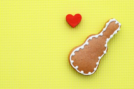 Music creative composition with gingerbread guitar on bright yellow background, copy space for text Фото со стока