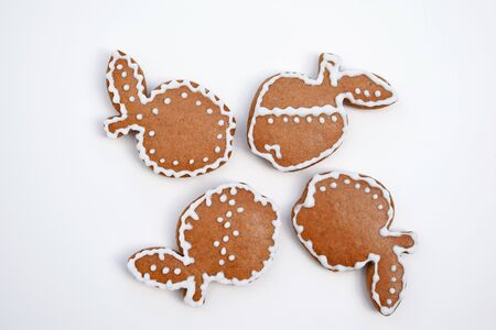 Gingerbread apples decorated by white icing