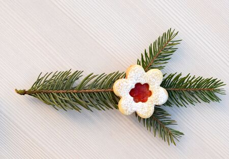 Tree branch with romantic linzer cookie