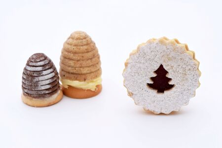 Two kinds of christmas cookies - wasp nests and linzer cookies