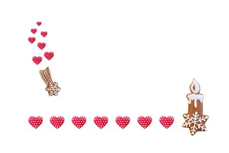 Creative composition with gingerbread candlestick, comet and red hearts.
