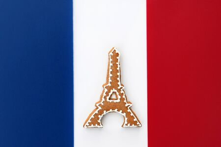 Eiffel tower gingerbread on background in France flag colors Stockfoto