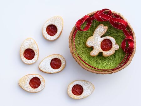 Linzer cookies in Easter shapes, filled with jam and sprinkled with powdered sugar