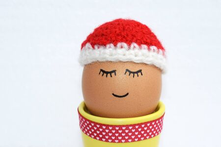 Cute egg with crocheted cap