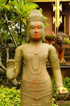 clam gardens: Cambodia Angkor statue in the garden Stock Photo