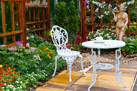 chair garden: beautiful garden and white table