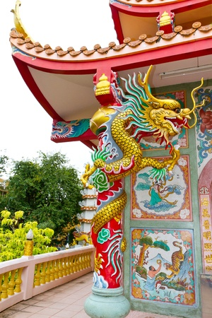 chinese temple and gold dragon photo