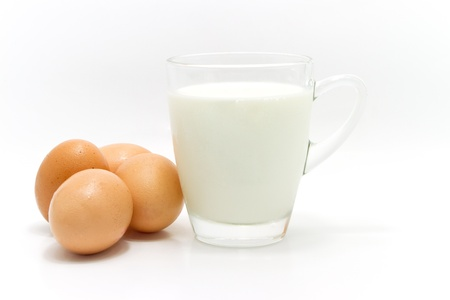 milk jugs: freash milk and eggs on white background