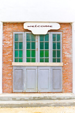 unkempt: vintage and old door with welcome note