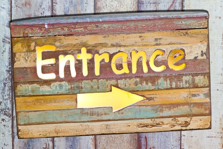 admitted: entrance on old plate on wooden board Stock Photo