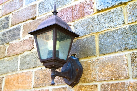 old lantern on vintage wall   Stock Photo - 11916289