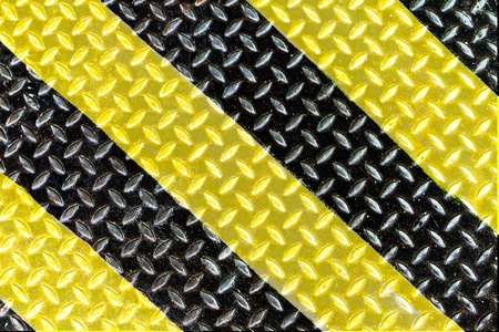 diamond plate: yellow and black strip on steel plate