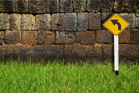 yellow sign at the old wall Stock Photo