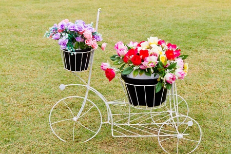 bicycle with artificial colorful flower photo