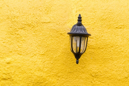 yellow lamp: vintage lamp on the yellow wall