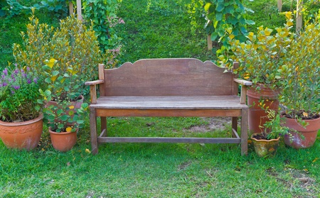 homelike: wooden chair in the garden