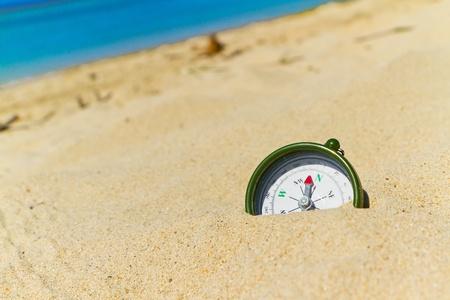 Bussola sulla spiaggia Archivio Fotografico
