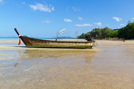 long tail boat on the beach  photo