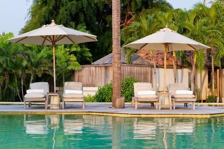 hin: beach chairs on the pool Stock Photo