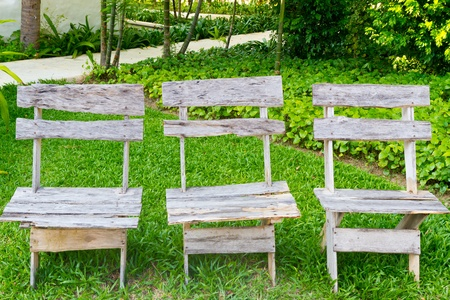 three wooden chairs in the garden  photo