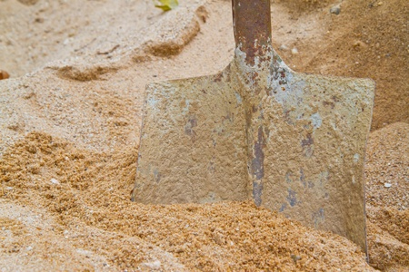steel shovel on sand photo