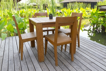 wooden chairs and tables on terrace Editorial