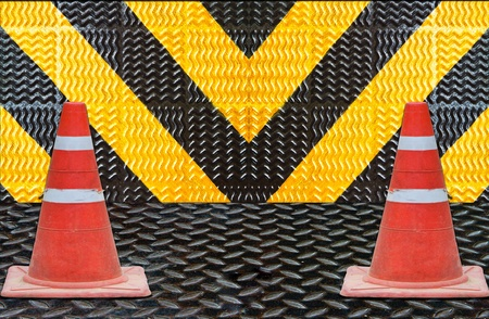 yellow and black striped background with traffic cones photo