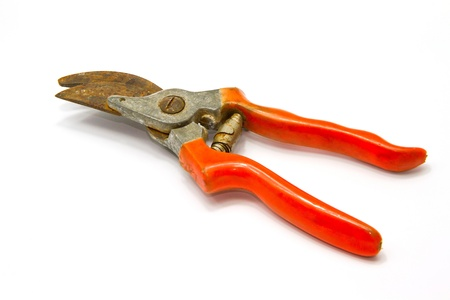 corrode: red pliers on white background Stock Photo