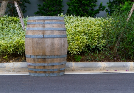 wooden barrel on the road Stock Photo - 13995416