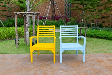 two wooden chairs in garden  photo