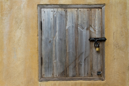 wooden door with padlock photo