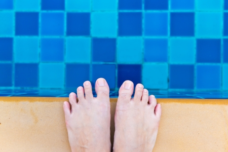 foot and swimming pool photo