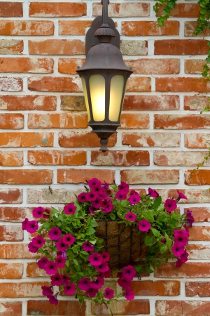 romantic places: old lantern with beautiful flowers Stock Photo