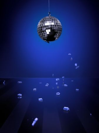 Broken disco ball isolated on blue background with pieces of mirror falling down on a shiny glass floor photo