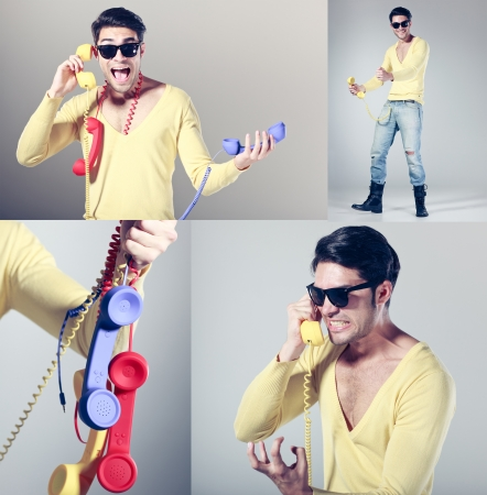 funny call center guy with hipster glasses and colouful phones Stock Photo - 16865356