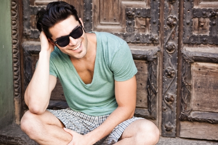 attractive man smiling wearing sunglasses