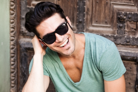 attractive macho: close-up of attractive man smiling wearing sunglasses