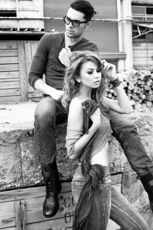Sexy and stylish young couple wearing jeans  Photo has an intentional film grain