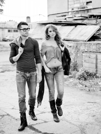 Sexy and stylish young couple wearing jeans  Photo has an intentional film grain   Stock Photo - 16865581