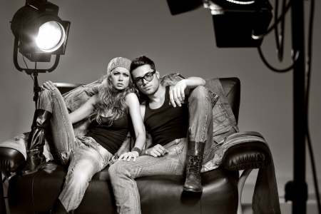 sexy love: Sexy man and woman doing a fashion photo shoot in a professional studio