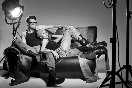 Sexy man and woman doing a fashion photo shoot in a professional studio Stock Photo - 16866126