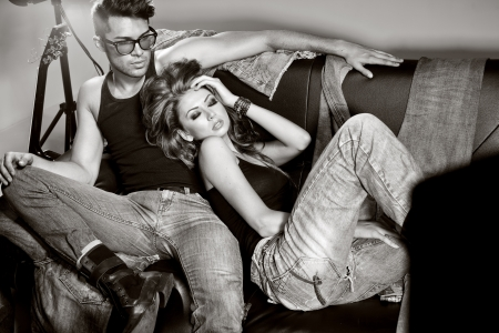 sexy photo: Sexy man and woman doing a fashion photo shoot in a professional studio
