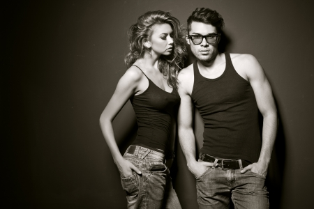 apparel: Sexy man and woman doing a fashion photo shoot in a professional studio