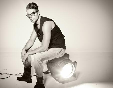 fashion shoot: Sexy man doing a fashion photo shoot in a professional studio