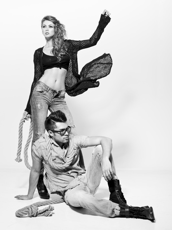 Sexy man and woman doing a fashion photo shoot in a professional studio Stock Photo - 16865397