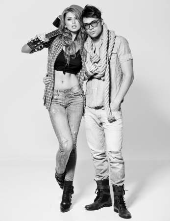 Sexy man and woman doing a fashion photo shoot in a professional studio - bw retro mood Stock Photo - 16865295