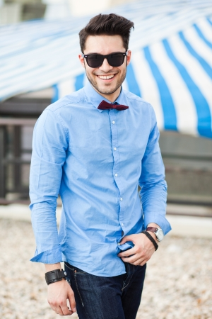 handsome young male fashion model dressed casual - outdoor Stock Photo